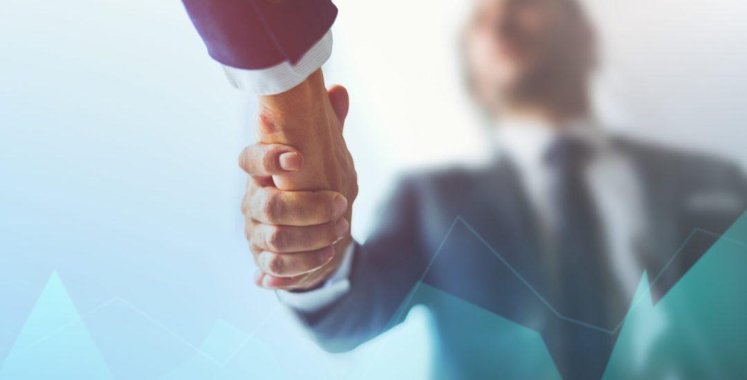 Business handshaking in agreement background